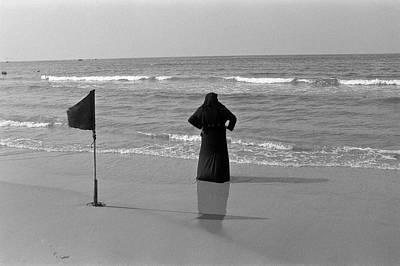 Arab Woman At The Tel Aviv Beach/black And Blue Poster by Kobi Amiel