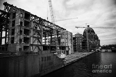 demolition of the Palast der Republik on the bank of the river Spree with the Berliner Dom in the background Berlin Germany Poster