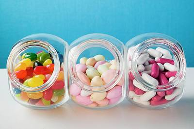Different Kinds Of Sweets In Three Sweet Jars Poster