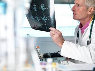 Doctor Viewing Brain Scan Poster by Tek Image