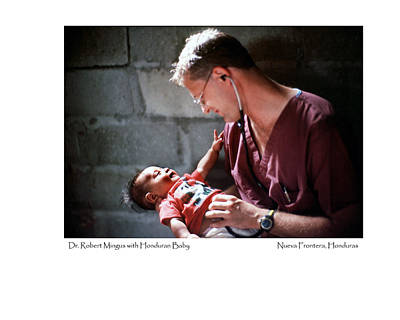 Poster featuring the photograph Doctor With Honduran Baby by Tina Manley