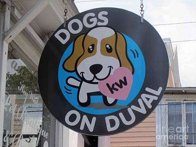 Poster featuring the photograph Dogs On Duval by Fiona Kennard