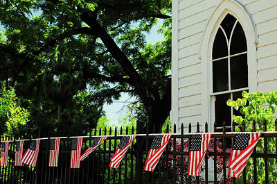 Draped Flags On Fence Of Church, July Poster