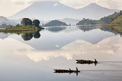 Dugout Canoe Floating On Lake Mutanda Poster by Martin Zwick