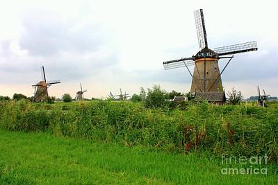 Dutch Landscape With Windmills Poster by Carol Groenen