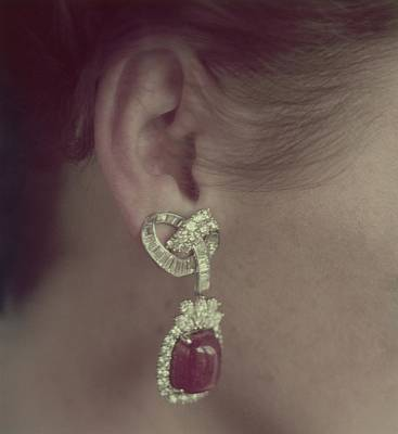 Ear Of A Model With A Ruby Earring Poster by Richard Rutledge