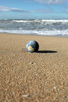 Earth On A Beach Poster by Detlev Van Ravenswaay