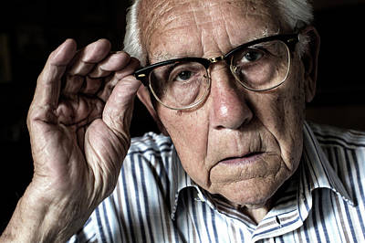 Elderly Man Adjusting His Glasses Poster by Mauro Fermariello