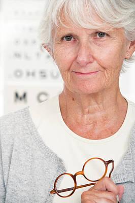 Elderly Woman Holding Glasses Poster
