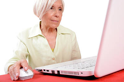 Elderly Woman Using A Laptop Computer Poster by Aj Photo