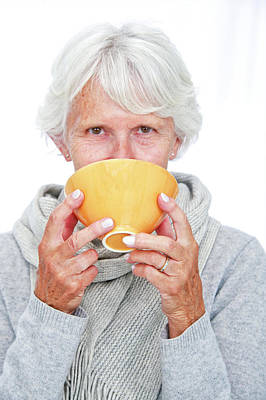 Elderly Woman With A Hot Drink Poster