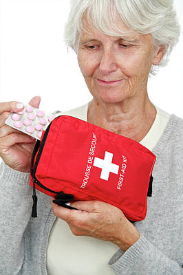 Elderly Woman With First Aid Kit Poster
