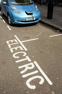 Electric Car At A Recharging Station Poster