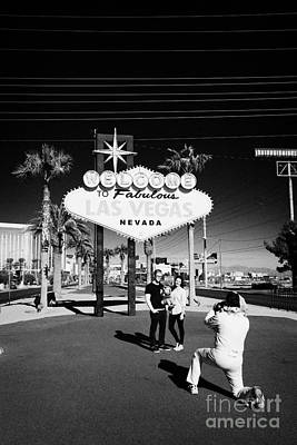elvis impersonator taking photos of tourists at the welcome to fabulous Las Vegas sign Nevada USA Poster by Joe Fox