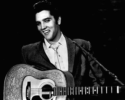 Elvis Presley Smiles While Holding Guitar Poster