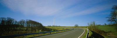 Empty Road Passing Through A Landscape Poster by Panoramic Images