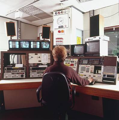 Engineer Siting In Front Of Control Panel Poster