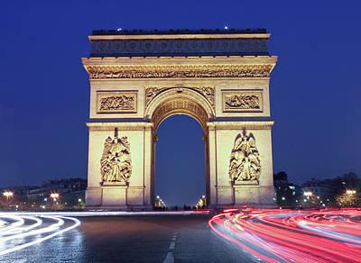 Evening Traffic Around The Arc De Poster by William Sutton