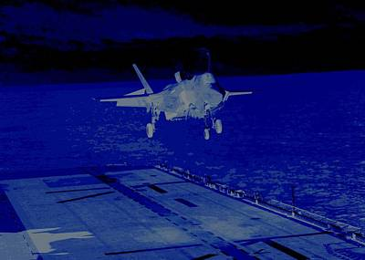 F 35 Joint Strike Fighter Landing Vertically On Us Marine Assault Carrier At Night Combat Conditions Poster by US Military - L Brown