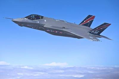 F 35 Joint Strike Fighter Lightening II Red And Indigo Vertical Angled Stabilizers Enhanced Poster by US Military - L Brown