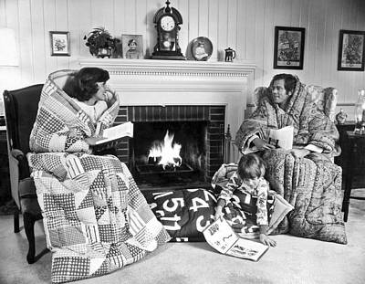 Family Huddled By Fireplace Poster by Underwood Archives
