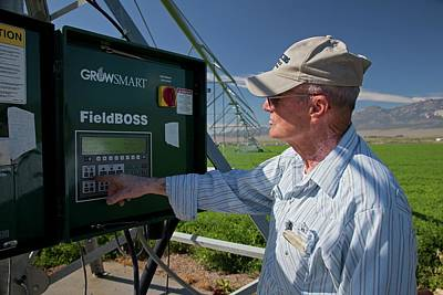 Farmer Adjusting Irrigation Controls Poster by Jim West