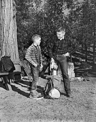 Father And Son Go Backpacking Poster by Underwood Archives