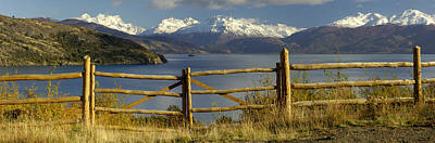 Fence In Front Of A Lake With Mountains Poster