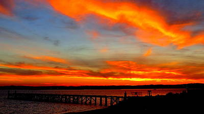 Fiery Skies And Silhouetted Pier Poster by Stephen Melcher