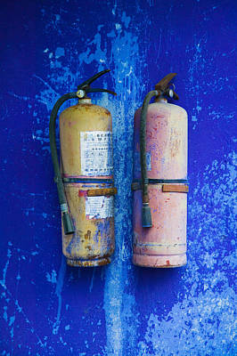 Fire Extinguishers On Blue Temple Wall Poster by Panoramic Images