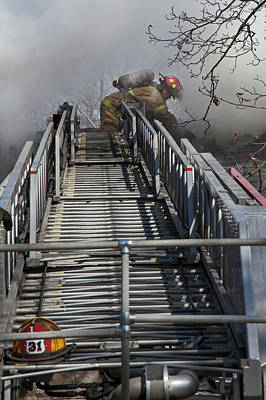 Firefighter On Telescopic Ladder Poster by Jim West