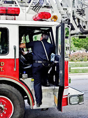 Fireman Climbing Into Fire Truck Poster by Susan Savad
