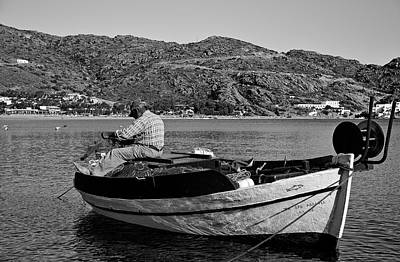 Fisherman Cleaning His Nets Poster by George Atsametakis