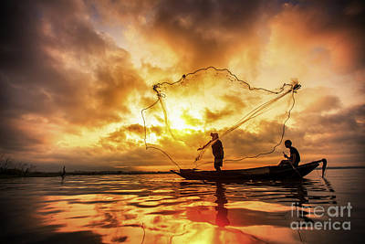 Fisherman Of Bangpra Lake In Action When Fishing Poster by Anek Suwannaphoom