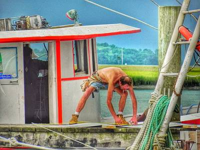 Fisherman Working On His Boat Poster by Patricia Greer