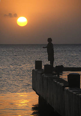 Poster featuring the photograph Fishing At Sunset by Paul Miller