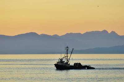 Fishing Boat Seen At Sunset Poster