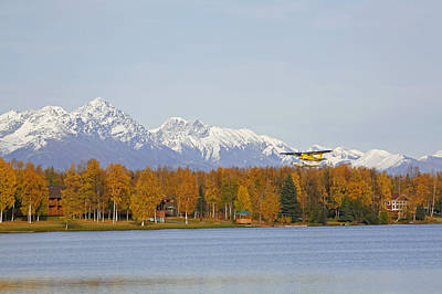 Float Plane Taking Off From Lake Poster by Calvin Hall
