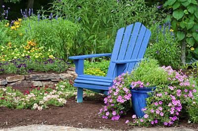 Flower Garden With Blue Adirondack Poster