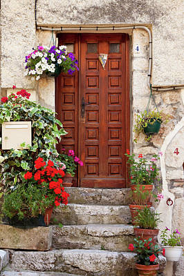 Flowers Surround The Front Door To Home Poster by Brian Jannsen