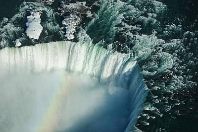 Flying Over Icy Niagara Falls Poster by Georgia Mizuleva