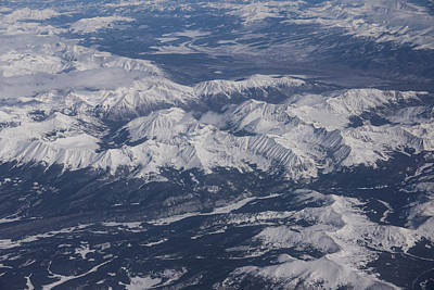 Flying Over The Snow Covered Rocky Mountains Poster
