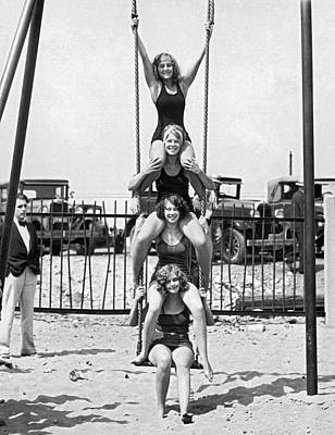 Four Girls On A Swing Set Poster by Underwood Archives