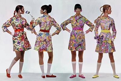 Four Models Wearing Colorful Print Dresses Poster