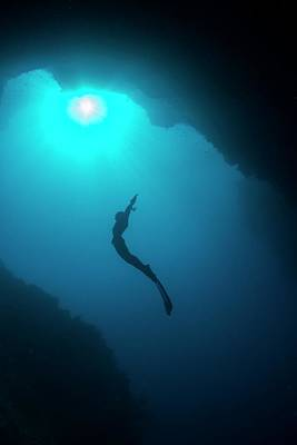 Free Diver In Mouth Of Cave Poster by Scubazoo