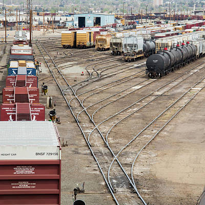 Freight Trains At A Rail Yard Poster by Jim West