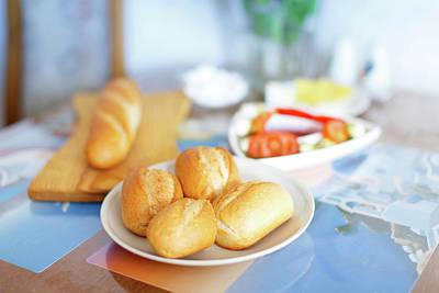 Fresh Bread Rolls On The Table Poster by Wladimir Bulgar