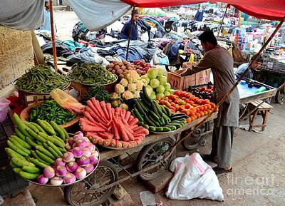 Fruit And Vegetable Seller Tends To His Cart Outside Empress Market Karachi Pakistan Poster by Imran Ahmed