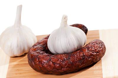 Smoked Sausage And Two Garlic Bulbs  Poster by Arletta Cwalina