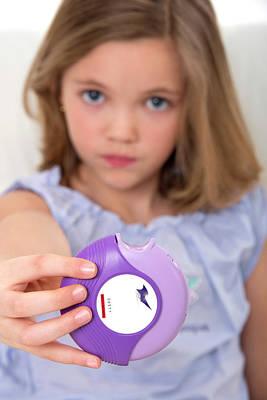 Girl Holding Asthma Medication Poster